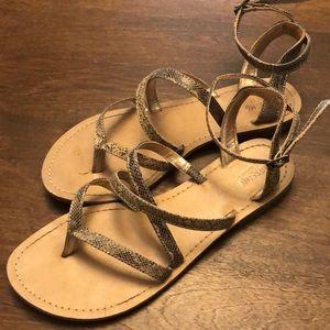 Strapped snake skin flat sandals